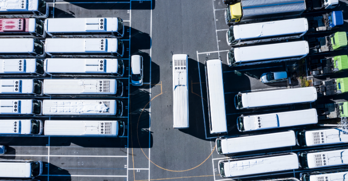 Why install a behaviour monitoring system? Birds eye view of bus depot station.
